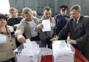 People cast ballots at a polling station during the referendum on the status of Donetsk and Luhansk regions, in Moscow