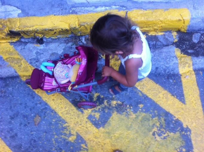 baby daphne pushing her toy stroller