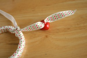 Adding-Bells-to-Ribbon