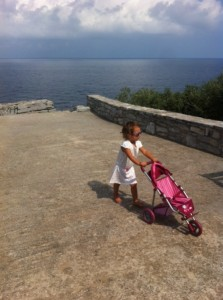 daphne pushing her toy stroller peleo pilio greece