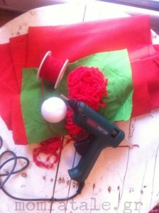 christmas yarn ball  glue gun red yarn