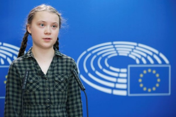 Swedish environmental activist Greta Thunberg addresses journalists during her visit to the European Parliament in Strasbourg