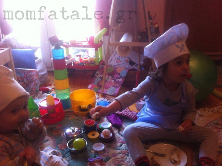 toddler girl playing chef